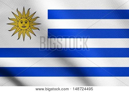 Uruguayan national official flag. Patriotic symbol banner element background. Flag of Uruguay waving in the wind with detailed fabric texture, illustration