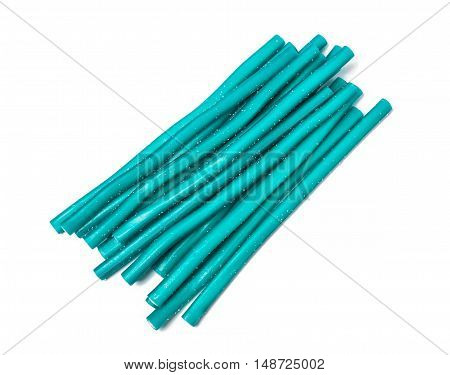 Sweet jelly licorice candy sticks in turquoise, isolated on white background