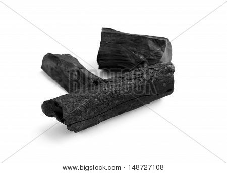 Black charcoal on white background raw material for make cooking
