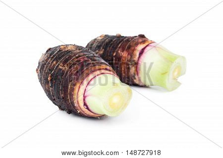 closeup of taro root on white background raw material for cooking concept