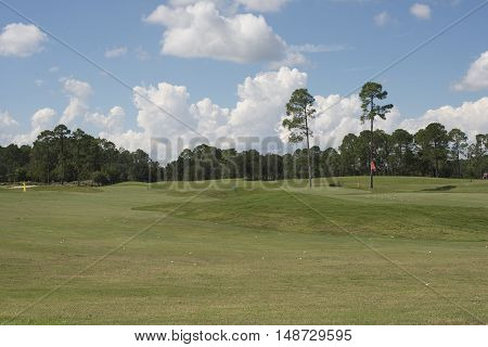 Golf course red flag in the countryside in sunny day