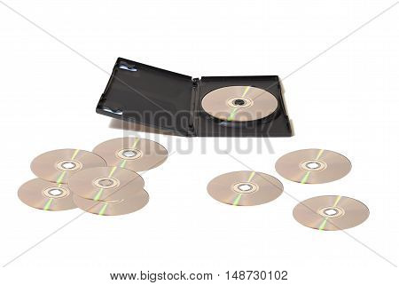 A DVD collection with scattered disks over a white table.