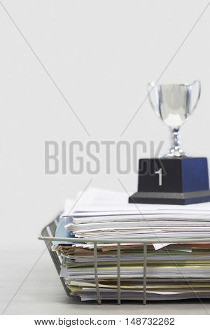 Trophy on Top of Papers