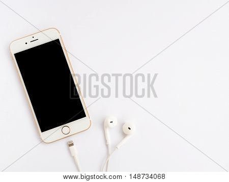CHIANGRAI THAILAND -SEPTEMBER 9 2016: Close-up image of new Apple iPhone 7 mockup and new Apple EarPods mockup on white background with copy space.