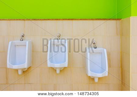 Row of Urinal in male restroom,white urinals in men's bathroom.