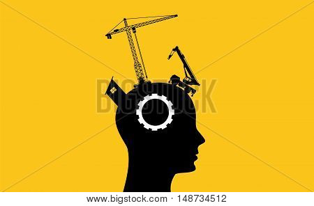 brain intelligence development concept with sillhouette human head and construction tools