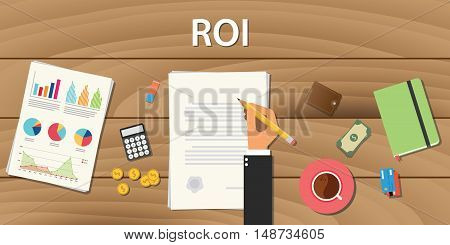 roi return on investment concept with hand work on some paper document with graph chart and wooden table