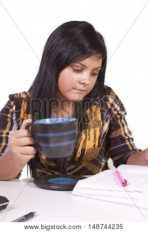 Cute Woman Studying At Her Desk