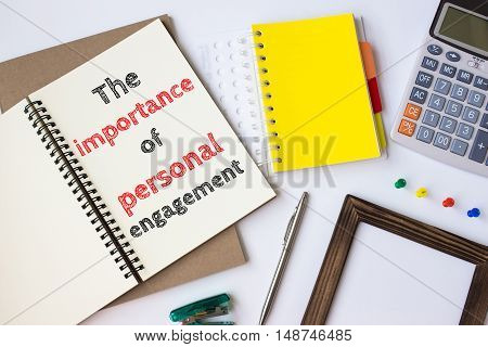 Text The importance of personal engagement on white paper book on table / business concept