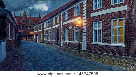 Full moon over the cobblestone street of the old town  - Night L