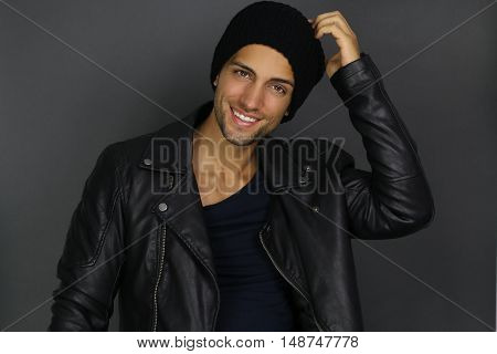 Handsome fashion man wearing a black hat