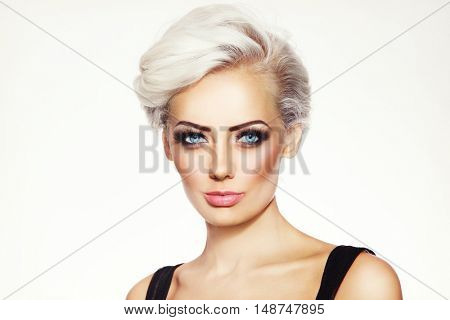 Portrait of young beautiful glamorous platinum blond woman with stylish make-up and hairdo