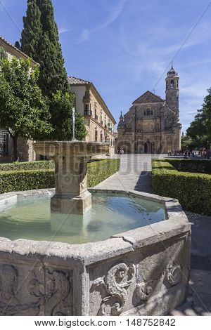 Ubeda Spain - September 18 2016: The Sacred Chapel of El Salvador (Capilla del Salvador) in the Plaza de Vazquez de Molina with the Parador hotel to the left Ubeda Jaen Province Andalusia Spain Western Europe