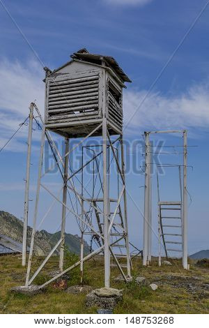 Old weather station in the top of the mountains. Abandoned old box for the meteorological equipment.