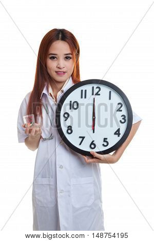 Young Asian Female Doctor Smile With A Clock And Pills.