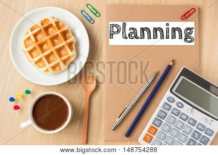 Planning, text message on paper book and office supplies, pen, coffee on wood desk , copy space / business concept / view from above, top view
