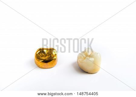 Dental ceramic and gold tooth crowns on white background. Isolated.