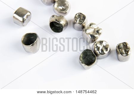 Dental metal tooth crowns on white background. Isolated.