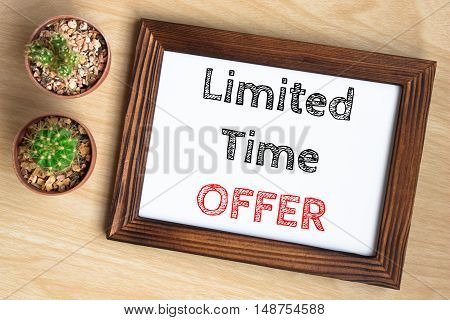 limited time offer, text message on wood frame board on wood table / business concept / Top view
