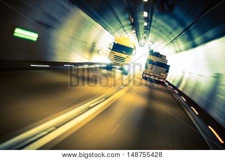 Speeding Trucks in the Tunnel. Trucking Road Transportation.