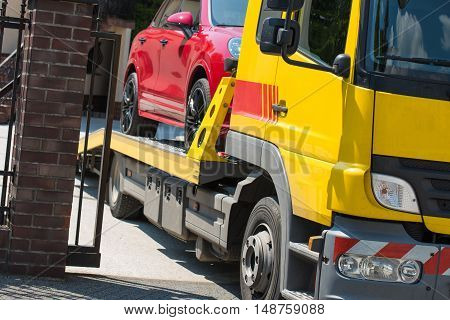 Car Towing Service. Modern Sport Utility Vehicle on the Towing Truck. Broken Car.