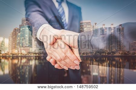 Business Man. Business handshake and business people on city background vintage tone. business concept. business man handshake on Bangkok background. Business handshake. Business people shaking hands.