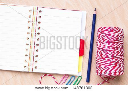 blank paper on desk / Open blank white paper notebook with copyspace and a pencil on a wood desk, view from above / for your text or message / top view