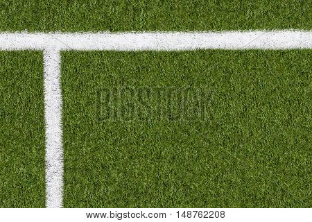 Further boundary line on green grass of sports field