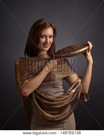Young Beautifu Woman With Coffee Beans