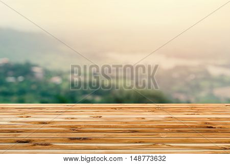 Wooden tables overlooking the lake, the mountains in countryside for background