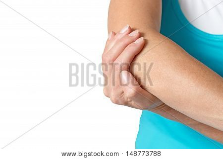 Middle age woman is holding her sore elbow. All is isolated on the white background. Empty place for your text is in the left half of the photo.