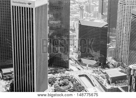LOS ANGELES, USA - MAY 27, 2015: Detail of the skyline of Downtown Los Angeles with the Bank of America Center in the foreground. The picture is in black and white.
