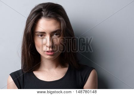 beauty and skincare concept, woman posing in the studio on light grey background with copyspace