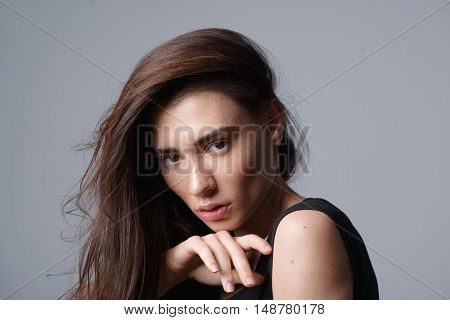 vogue and skincare concept, portrait of a young graceful brunette looking into camera with copyspace