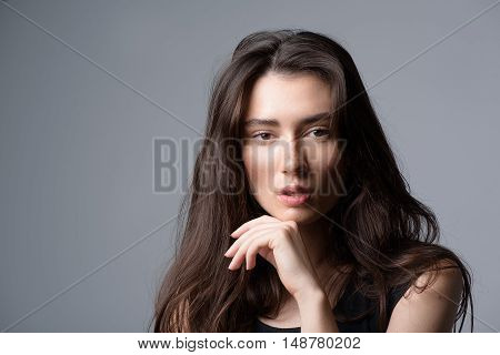 beauty concept, portrait of a calm pretty girl looking into camera