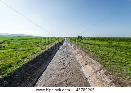 Water irrigation canal. Irrigation of farm fields