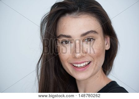 beauty and skin care concept, portrait of a happy smiling girl looking into camera