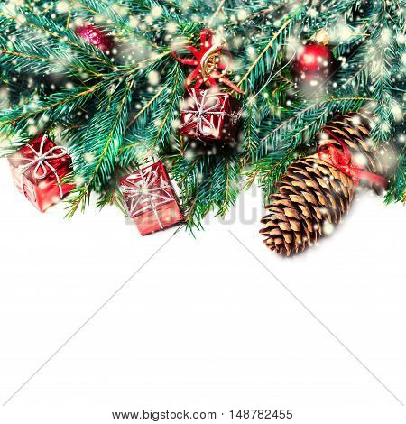 Christmas fir tree with decoration isolated on white - Christmas background with a red ornament gift boxes pine and snowflakes with copyspace