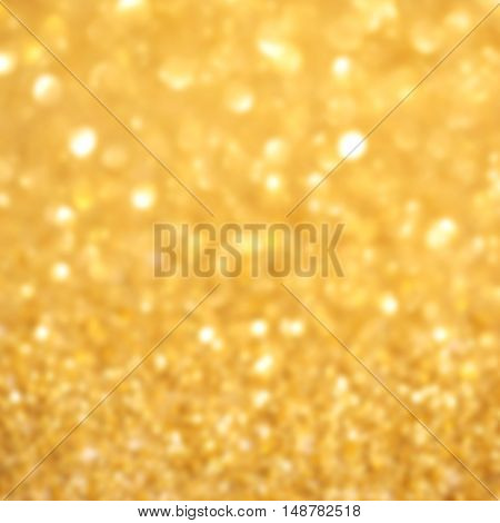 Golden glitter Christmas abstract background with defocused sparkle lights