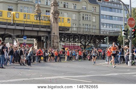 BERLIN GERMANY - SEPTEMBER 25 2016: Spectators And Runners At Berlin Marathon 2016 Underground Train In Background