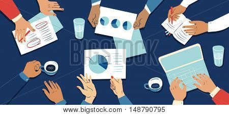 Concept of business meeting with the hands of businesspeople working with a laptop, notepad, charts and documents.