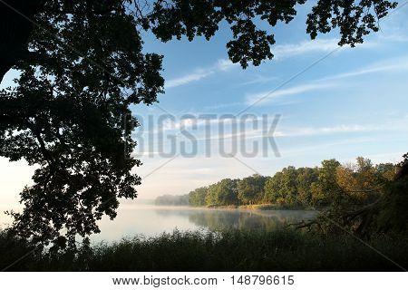 Sunrise over the lake. September, Poland.
