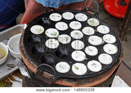 Process Of Cooking Sweet And Savory Grilled Coconut-rice Hotcakes, Coconut Rice Cake On Banana Packa