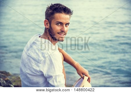 Handsome Young Man in Trendy Attire, on a Beach in a Sunny Summer Day, Wearing a White Shirt