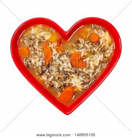 Vegetarian Wild Rice Soup in Heart Shaped Bowl Isolated on a white background. Selective focus.