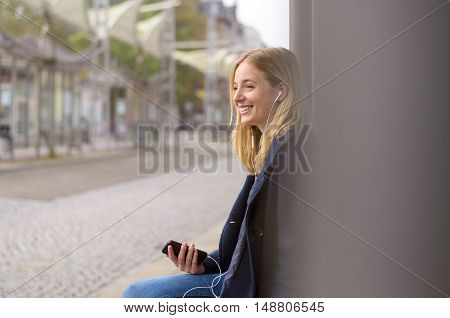 Happy Young Woman Relaxing Waiting For A Bus