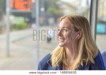 Attractive Smiling Woman Listening To Music