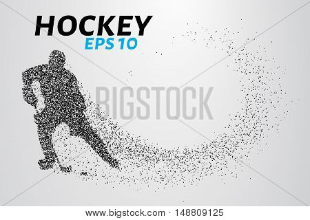 Hockey player of the particles. Silhouette of a hockey player consists of small balls and scatters in the wind.