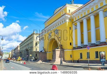 SAINT PETERSBURG RUSSIA - APRIL 25 2015: The view on Empire Style Admiralty building with the old anchors on the plintes from embankment of Neva river on April 25 in Saint Petersburg.