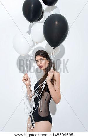 young beautiful woman posing on white background